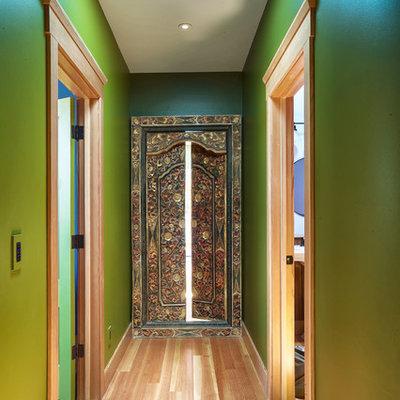 Hallway - cottage light wood floor hallway idea in San Francisco with green walls