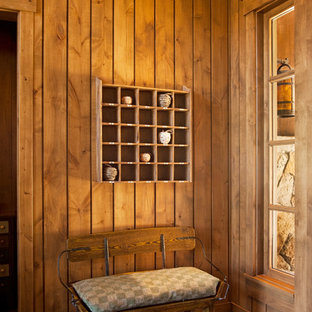 Mountain style medium tone wood floor hallway photo in Sacramento