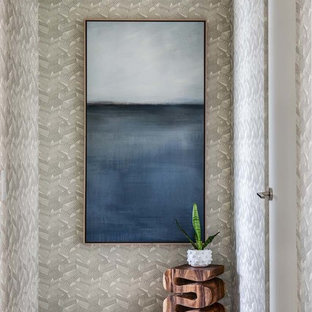 Mid-sized beach style hallway in Orange County with grey walls, grey floor and dark hardwood floors.