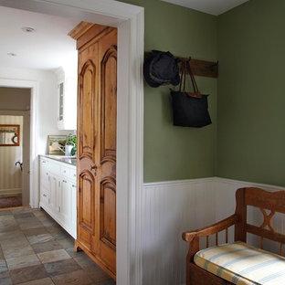 На фото: коридор среднего размера в стиле современная классика с полом из сланца с