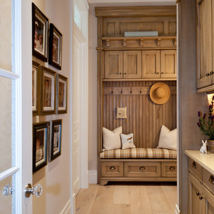 Inspiration for a traditional hallway in Miami with white walls, light hardwood floors and beige floor.