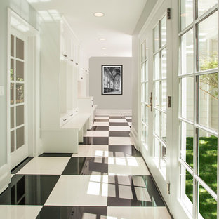 Large elegant porcelain floor hallway photo in Seattle with gray walls
