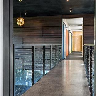 Trendy concrete floor and gray floor hallway photo in Minneapolis with brown walls