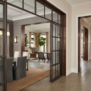 Huge elegant limestone floor and gray floor hallway photo in Chicago with gray walls