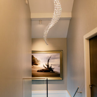 Inspiration for a mid-sized contemporary medium tone wood floor and brown floor hallway remodel in Vancouver with gray walls
