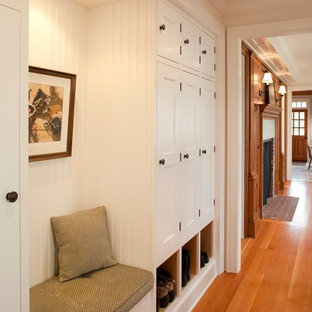 Hallway - large traditional medium tone wood floor hallway idea in Seattle with white walls