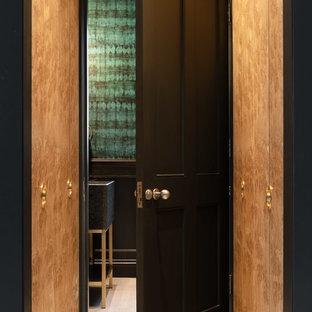 Trendy terrazzo floor and beige floor hallway photo in London