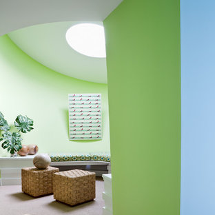 Design ideas for a large beach style hallway in New York with green walls, carpet and beige floor.