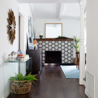 Photo of a mid-sized midcentury hallway in Los Angeles with white walls and dark hardwood floors.