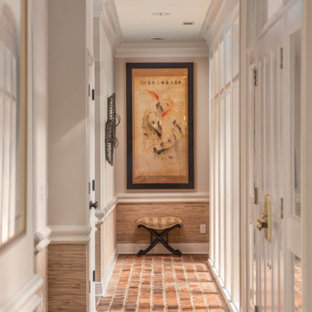 Design ideas for a mid-sized beach style hallway in Atlanta with multi-coloured walls, brick floors and red floor.