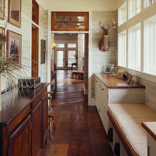 Mid-sized country hallway in Atlanta with dark hardwood floors and white walls.