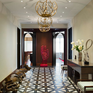 Example of a huge trendy marble floor and black floor hallway design in New York with beige walls