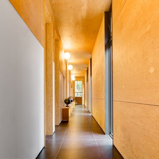 Photo of an expansive midcentury hallway in Toronto with porcelain floors.