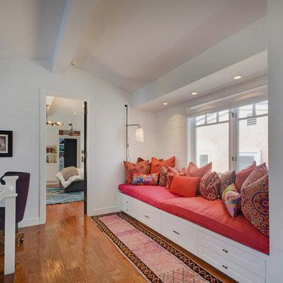 Hallway - transitional medium tone wood floor and brown floor hallway idea in Los Angeles with white walls