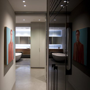 Example of a mid-sized minimalist concrete floor hallway design in Vancouver with gray walls