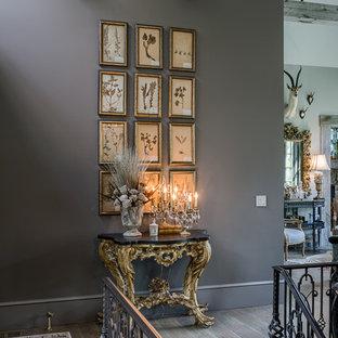 Hallway - traditional medium tone wood floor and brown floor hallway idea in Other with gray walls