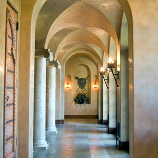 Tuscan hallway photo in Orange County with beige walls