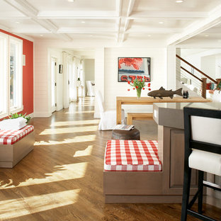 This is an example of a large beach style hallway in Boston with red walls and medium hardwood floors.