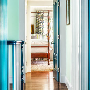 Inspiration for a mid-sized beach style hallway in Boston with green walls and medium hardwood floors.