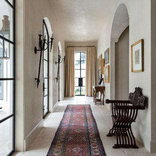 Hallway - mediterranean hallway idea in Houston with white walls