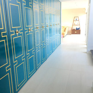 Design ideas for a mid-sized midcentury hallway in Orlando with blue walls, slate floors and white floor.