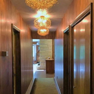 Design ideas for a mid-sized midcentury hallway in Other with cork floors.