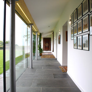 Hallway - large contemporary hallway idea in Other