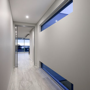 Mid-sized minimalist porcelain floor hallway photo in Perth with white walls