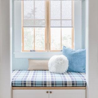 Hallway - mid-sized cottage light wood floor and beige floor hallway idea in Houston with white walls