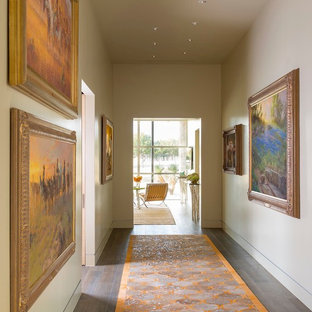 Inspiration for an expansive midcentury hallway in Austin with beige walls and porcelain floors.