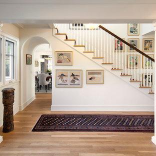 Hallway - mid-sized traditional light wood floor hallway idea in Santa Barbara with white walls