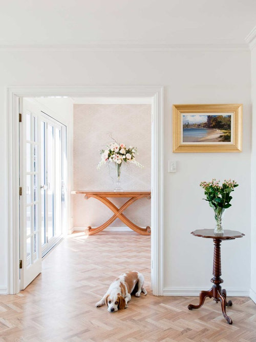 Inspiration For A Large Transitional Medium Tone Wood Floor Hallway Remodel  In Perth With White Walls
