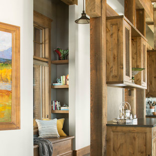 Example of a mountain style brown floor and dark wood floor hallway design in Denver with white walls