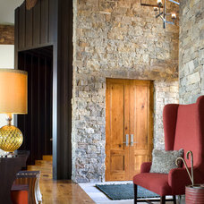 Rustic Hall by Studio 80 Interior Design