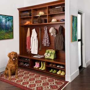 Inspiration for a mid-sized timeless dark wood floor hallway remodel in New York with white walls