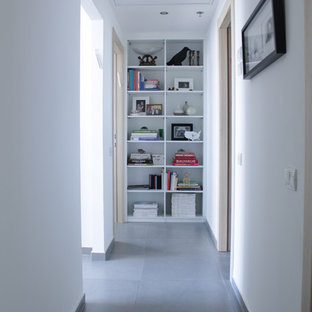 Hallway - contemporary gray floor hallway idea in Tel Aviv with white walls