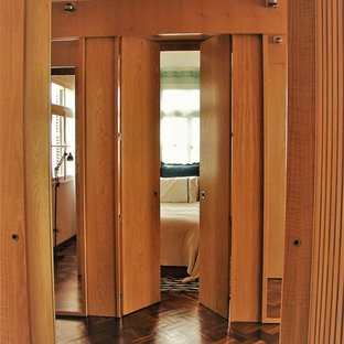 Example of a trendy plywood floor hallway design in Other