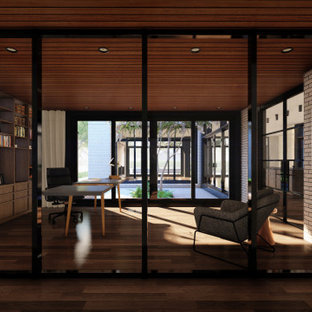 広いモダンスタイルのおしゃれな廊下 (無垢フローリング、板張り天井、レンガ壁) の写真