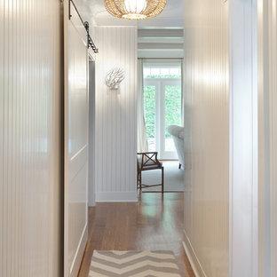 Beach style hallway in Boston with white walls and medium hardwood floors.