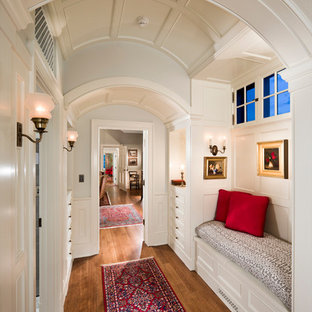 Design ideas for a traditional hallway in Santa Barbara with white walls and medium hardwood floors.