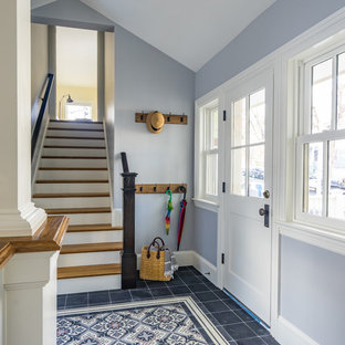 Large transitional concrete floor and black floor hallway photo in Boston with gray walls