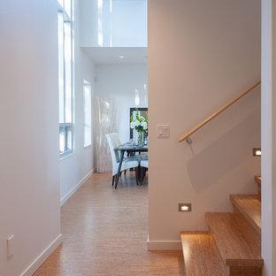 Trendy cork floor hallway photo in Vancouver with white walls