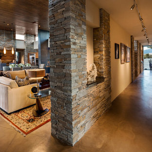 Example of a large southwest concrete floor and gray floor hallway design in Phoenix with beige walls