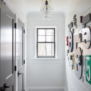 Photo of a beach style hallway in Manchester with white walls and grey floor.