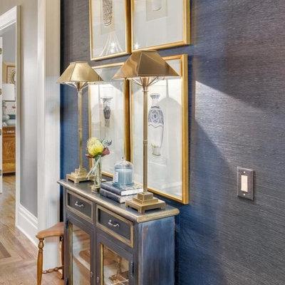 Example of a trendy medium tone wood floor hallway design in Nashville with blue walls