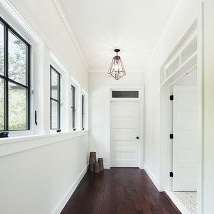 Hallway - scandinavian dark wood floor hallway idea in New York with white walls