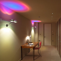 Occhio Lighting - Occhio lighting a hallway. Splashes of vibrant colour from the removable colour filters.  Occhio modular nature allows these filters to be swapped over as simply as changing a CD.