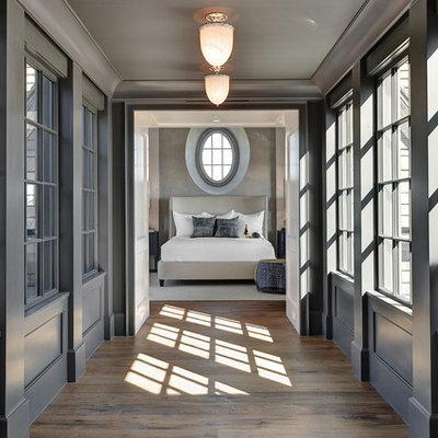 Example of a beach style medium tone wood floor hallway design in Charleston with gray walls