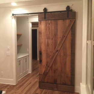 Hallway - mid-sized cottage medium tone wood floor hallway idea in Nashville with white walls