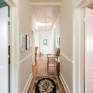 Eclectic light wood floor and brown floor hallway photo in Houston with white walls